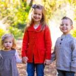 três jovens irmãos — Fotografia Stock  #37426839