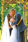 Wedding Ceremony Bride and Groom Kiss — Stock Photo