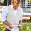 Stock Photo: Groom Reading Vows for Wedding
