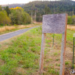 Blank Wooden Sign by Road — Stock Photo