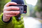 Manfrotto iPhone Lens Photographer — Stock Photo