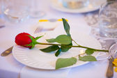 Red Rose on Wedding Dinner Plate — Stock Photo