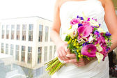 Bride Holding Bouquet of Mixed Flowers — Stock Photo