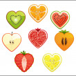 Stock Photo: Cut differend fruits and berries in the shape of a heart on a white background.