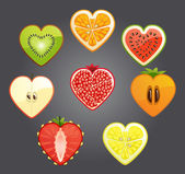 Cut of differend fruits and berries in the shape of a heart. Vector. — Stock Vector