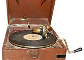 Retro turntable with a dusty record in the open suitcase — Stock Photo