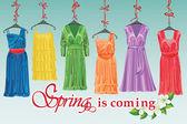 Colorful fashion cocktail dress hang on ribbon.Big sale — Stock Vector