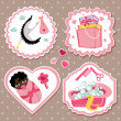 Label set with items for mulatto newborn baby girl — Stock Vector #44835179