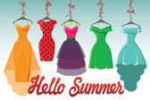 Colorful fashion colored dresses hang on ribbon.Hello summer! — Stock Photo