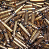 Pile of used pistol and rifle cartridges — Stock Photo