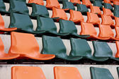 Rows of red mini-football stadium empty seats — Stock Photo