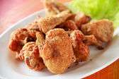 Fresh fried chicken on a white plate — Stock Photo