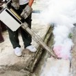Stock Photo: Fogging into drain to prevent spread of dengue fever