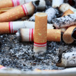 Many cigarette butts for backgrounds — Stock Photo