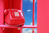Vintage Telephone box with blue sky. — Stock Photo