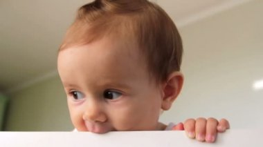 Little baby looking into camera (emotion),small child cheerfully plays — Video Stock