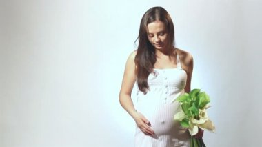 Pregnant woman with a flower — Stock Video