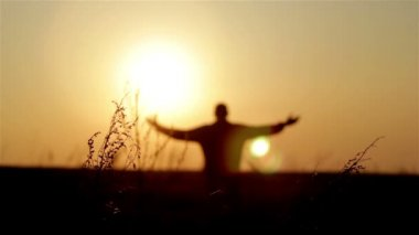 Silhouette of man on the sunrise. Freedom concept. Harmony concept. — Stock Video