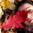 Portrait of a beautiful girl in the autumn forest (close-up) — Stock Video