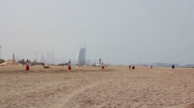 Dubai.UAE.Burj Al Arab in February 2014.Jumeirah beach promenade.Dubai Offshore SailingClub. — Stock Video
