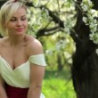 Young beautiful girl posing at the camera in the flowering spring garden,Beautiful girl in spring garden,Beautiful young woman enjoying in spring garden — Stock Video #46411441