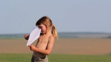 Boy launches a paper airplane.Child playing with paper airplane. — Stock Video
