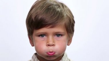 Portrait close up of smiling boy face. Child face close up suffering toothache (emotions). — Stock Video