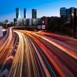 Blurred Tail Lights And Traffic Lights On Motorway — Stock Photo #36362377