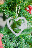 Grey heart on christmas tree decoration — Stock Photo
