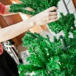 How to shape artifical Christmas tree — Stock Photo #37429473