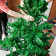 How to shape artifical Christmas tree — Stock Photo #37429479