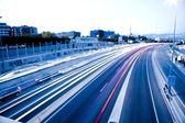 Blurred Tail Lights And Traffic Lights On Motorway — Stock Photo