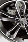 Car wheel in motorshow — Stock Photo