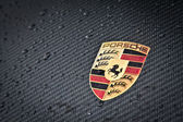 Porsche emblem carbon — Stock Photo