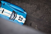 Old race car in action on track — Stock Photo
