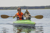 Adult Man in a Canoe with a Dog — Stock Photo
