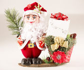 Santa Claus with Basket, Parcel and Fir — Stock Photo