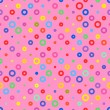 Pink background fabric with colored circles seamless pattern — Stock Vector