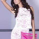 Attractive brunette beauty posing in elegant dress. — Stock Photo