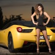 Beautiful brunette lady with sports car. — Stock Photo #37647831