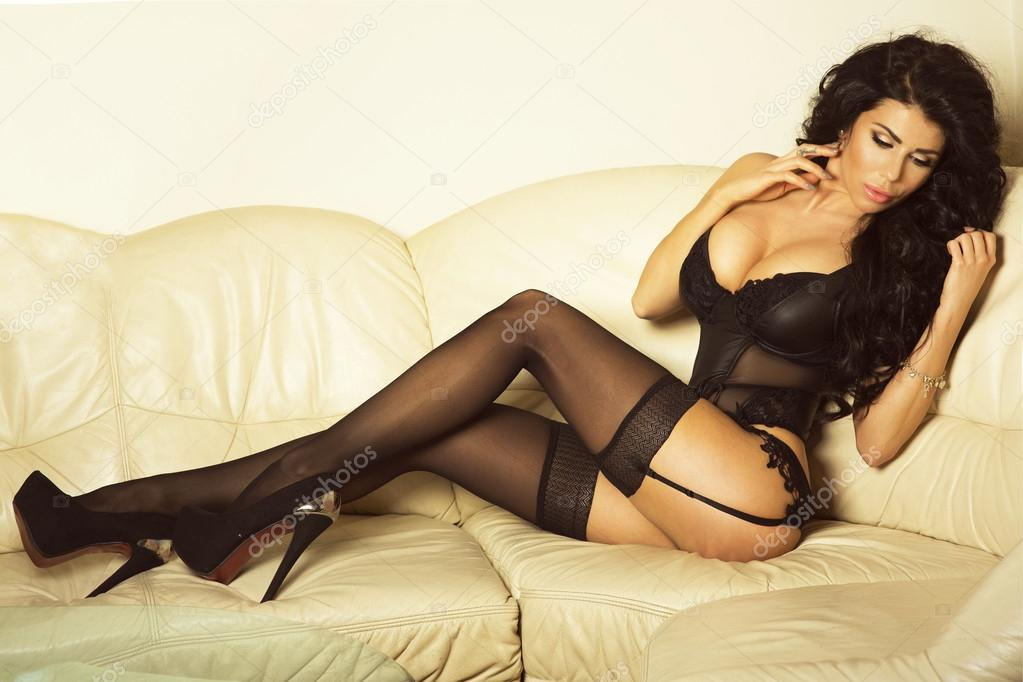 Hot brunette with tattooed and nice tits poses in mesh stockings № 732186 бесплатно