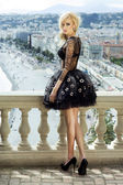 Attractive blonde beauty posing in dress. — Stock Photo