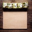 Notebook paper with gift box — Stock Photo