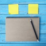 Notebook on desk — Stock Photo