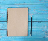 Notebook on desk — Stock Photo