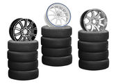 Car alloy wheel on tires isolated over white background — Stock Photo