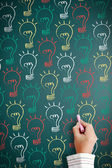 Drawn light bulbs on blackboard. — Stock Photo