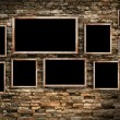 Old photo frames on old brick wall texture, grunge industrial interior — Stock Photo #42386245