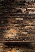 Empty wood shelf on brick wall texture background.  Loft style concept design — Stock Photo