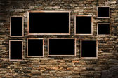 Old  photo frames on old brick wall texture, grunge industrial interior — Stock Photo